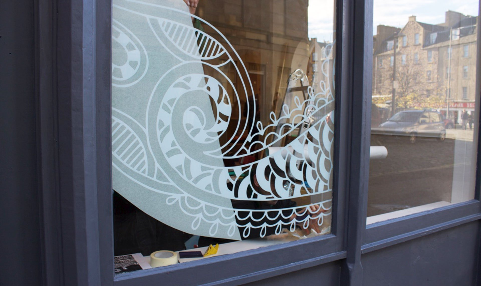 Bindi design painted on window inspired by henna artwork