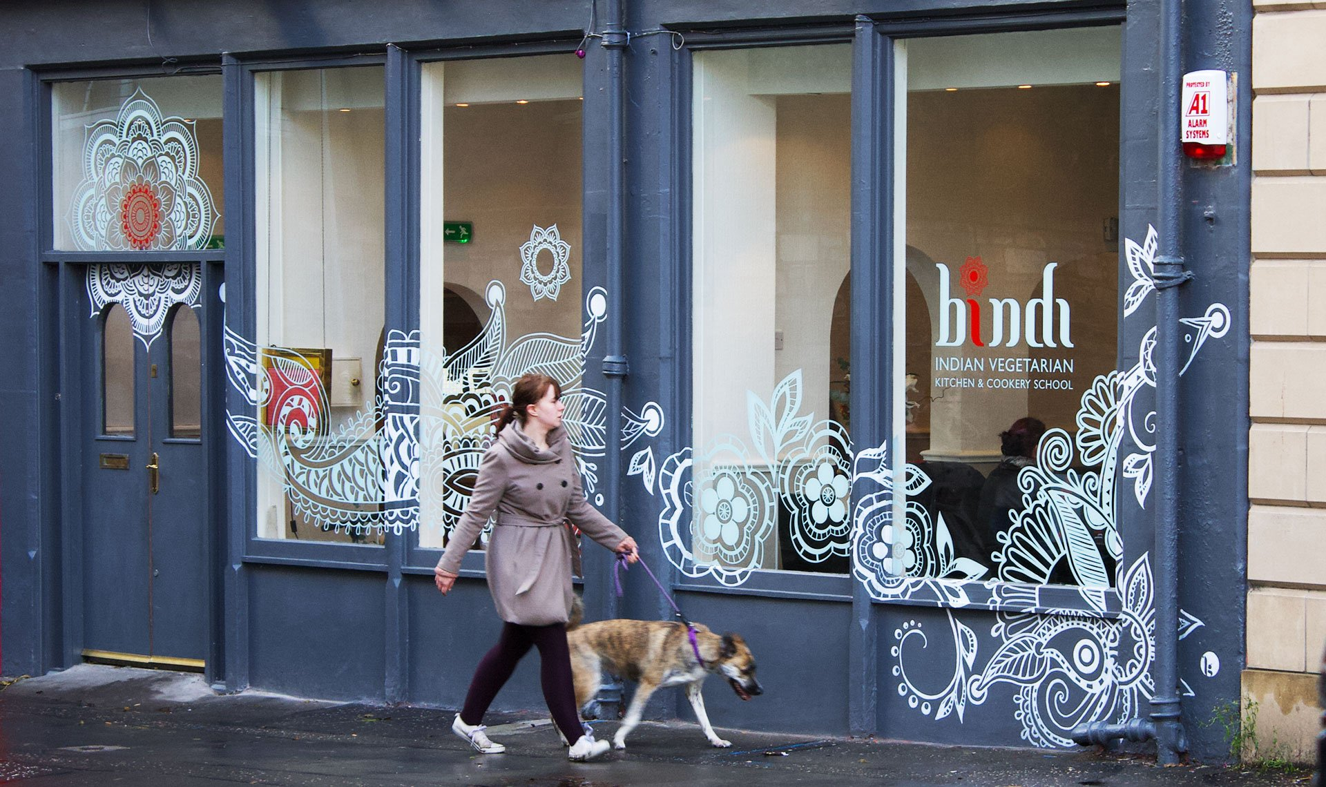 Bindi based on henna art painted on wall exterior of restaurant and window