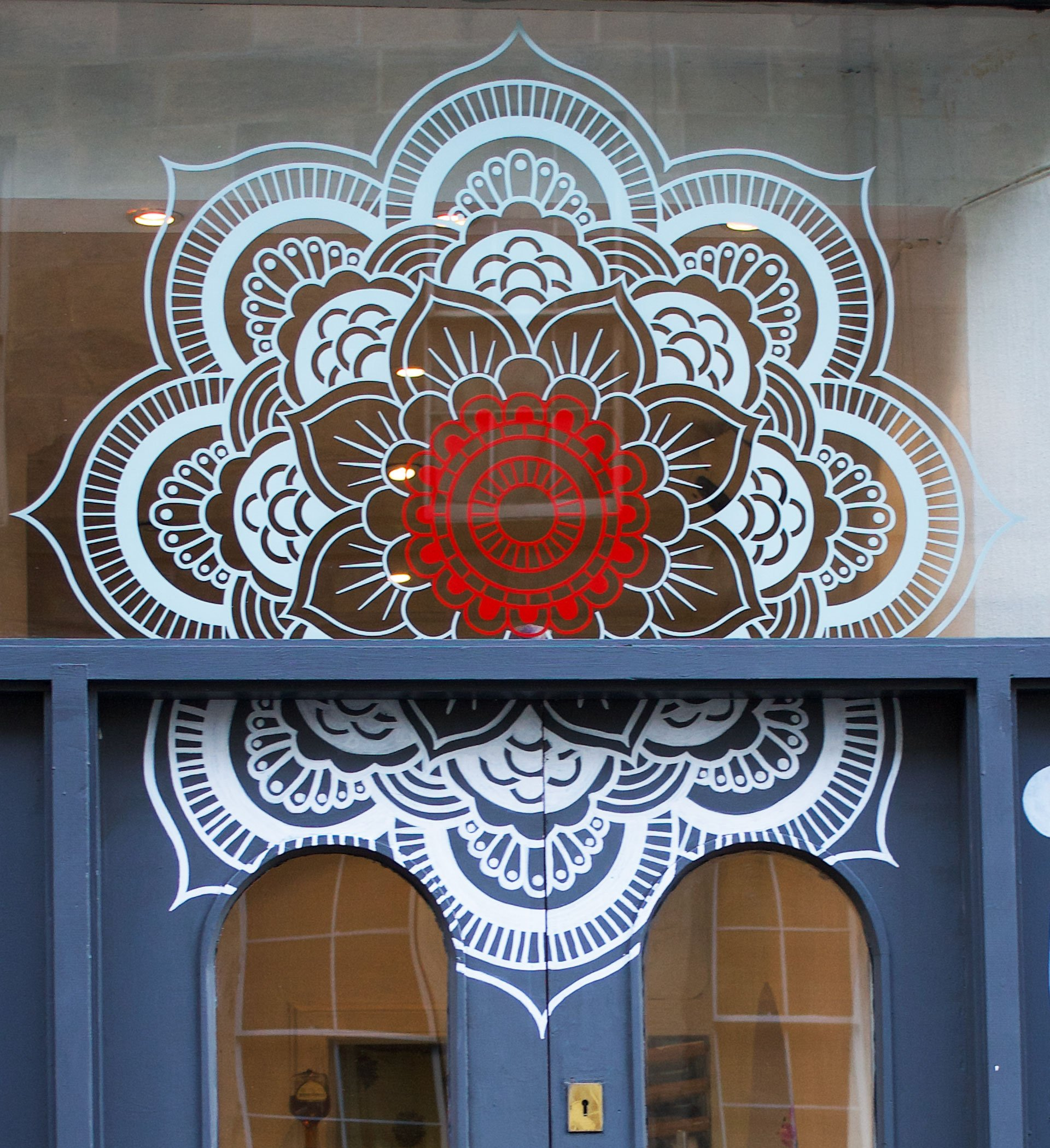Bindi wall art based on Mandala painted on door and window