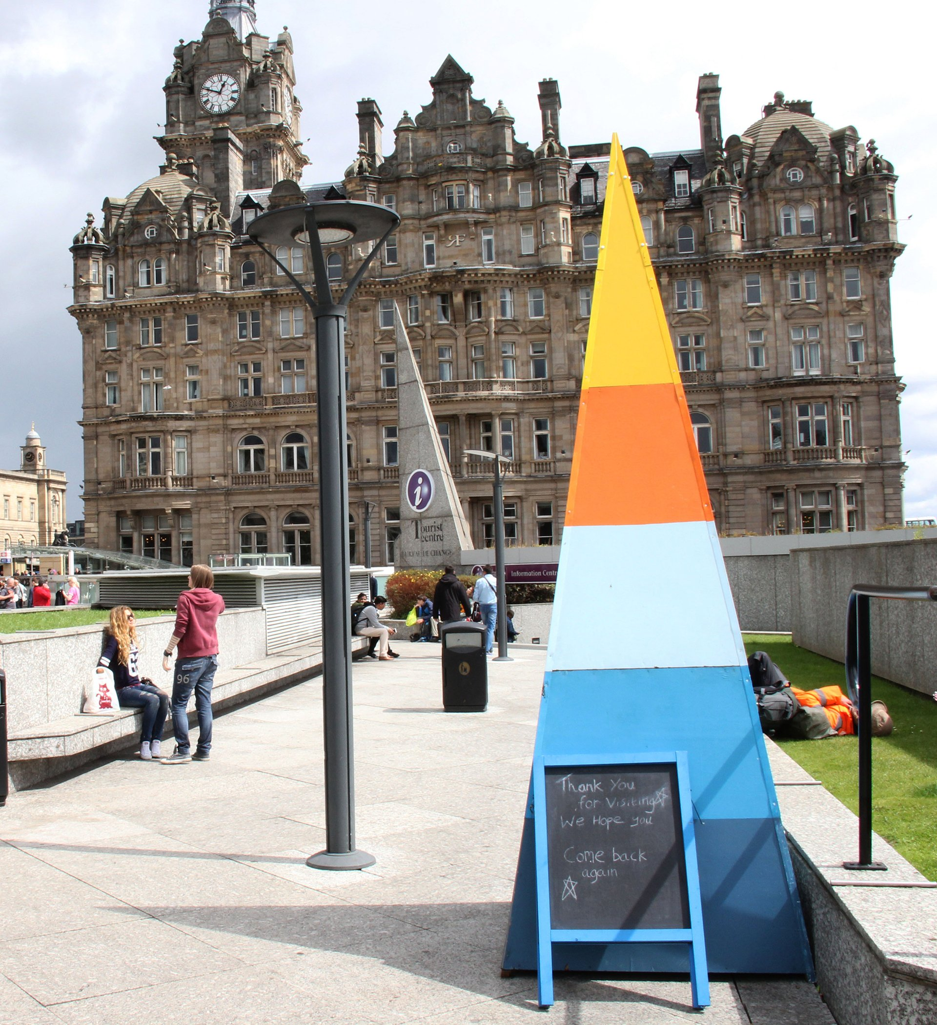 BoxSmall wooden pyramid structure painted with bright colours