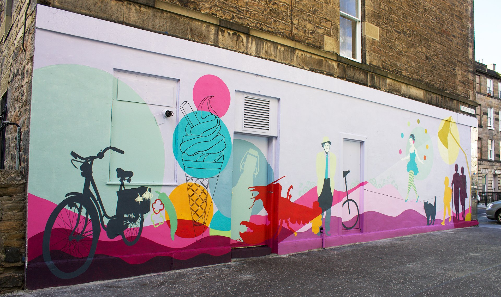 Gifford Park Mural in bright pinks and blues with artworks including ice-cream cone, a juggling tightrope walker and bicycle